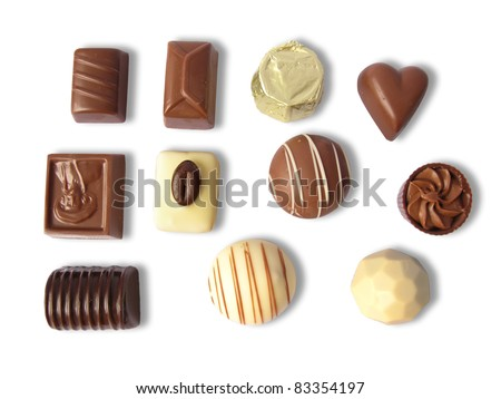 Different chocolates in various shapes, isolated in white - stock photo