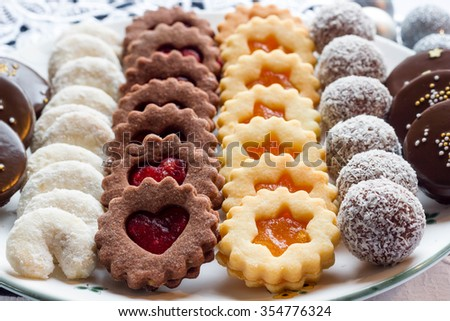 Different christmas cookies on a white plate. - stock photo