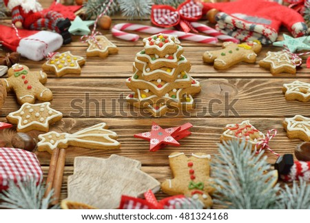 Different Christmas decorations on brown background