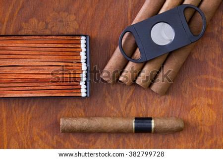 Different cigars on the decorative wooden table - stock photo
