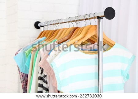 Different clothes on hangers close up - stock photo