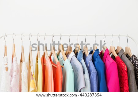 Different clothes on the rack - stock photo