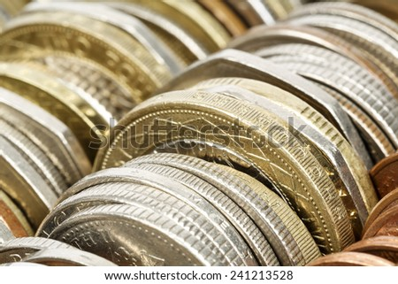 Different coins shown up close, forms the backdrop - stock photo