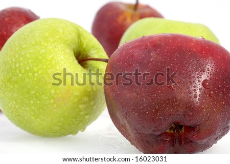 different colored apples on white background