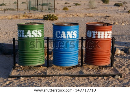 Different Colored Bins For Collection Of Recycle Materials near Svakopmund desert, place with biggest desert flower welvitchia mirabilis in Namibia  - stock photo