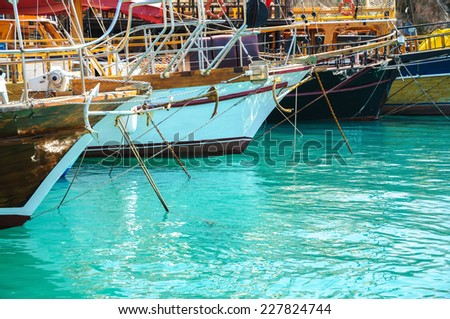 different colored boats yachts moored in a harbor - stock photo