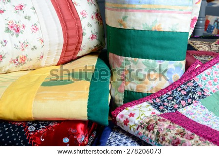 different colored patchwork stacked on a table