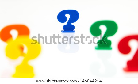 Different colored unique pawns isolated on a white background - stock photo