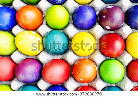Different colorful Easter eggs, happy holiday, chicken egg, traditional Christian easter time painted eggs, rainbow colors