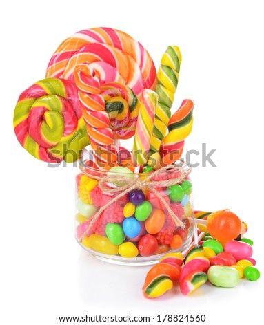 Different colorful fruit candy in jar isolated on white