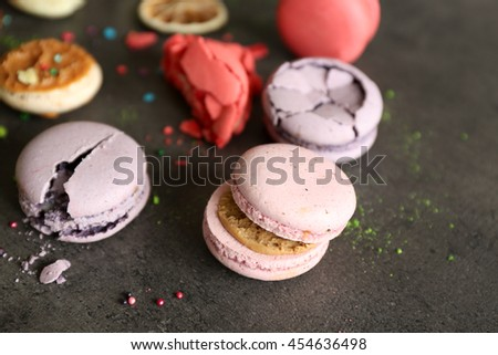 Different colorful macaroons on gray background - stock photo