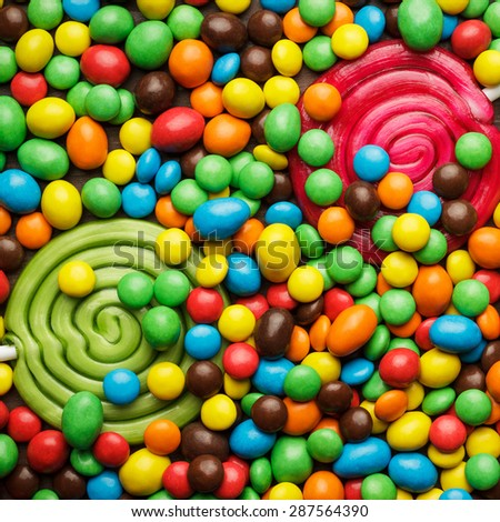 different colorful sweets and lollipops on the table - stock photo