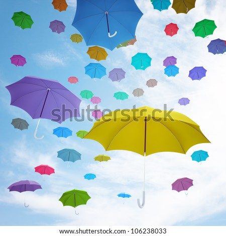 Different colorful umbrellas flying high in the air