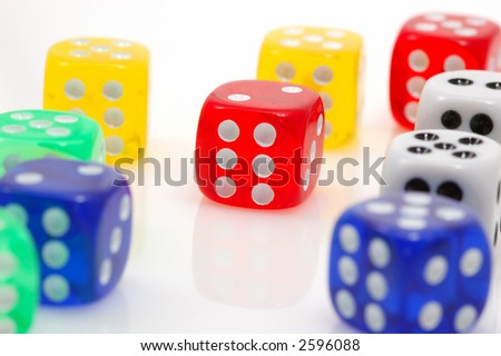 different colors of dices ...focus in red dice.. casino concept