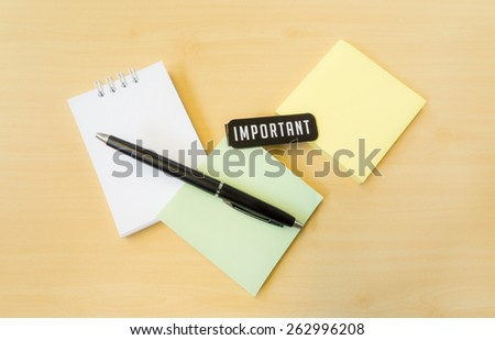 Different Colors of Postit with Important Word and Black Pen on  - stock photo