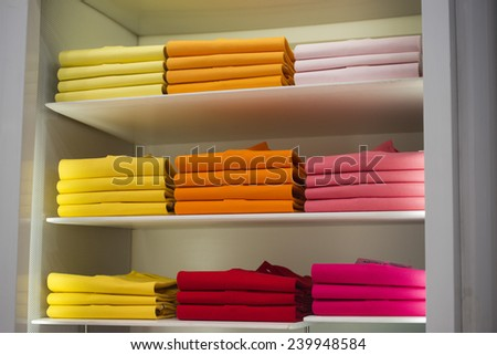 different colors polo shirt on display stand