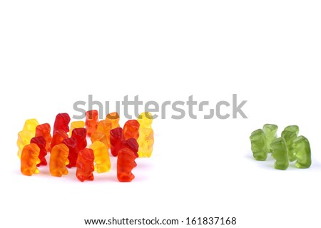 Different coloured gummi bears demonstrating exclusion - stock photo