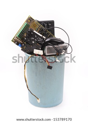 different computer parts in trash can - stock photo