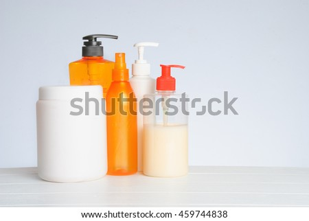 Different cosmetic bottles for personal care isolated on white background