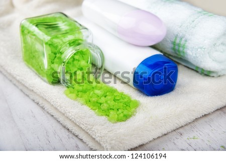 different cosmetic for body,shampoo, body wash, bath towel, bath salt, cream for face and body, deodorant, antiperspirant - stock photo