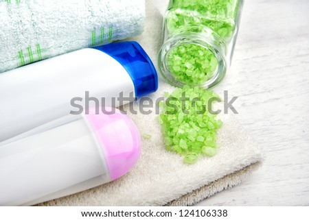 different cosmetic for body,shampoo, body wash, bath towel, bath salt, cream for face and body - stock photo