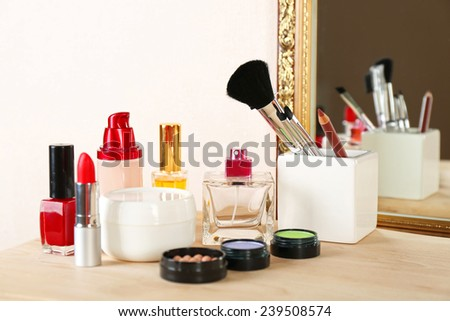 Different cosmetics on dressing table, close up - stock photo