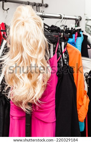different costumes and wigs in the dressing room of a small theater - stock photo