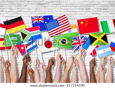 Different countries united with their flags raised. - stock photo