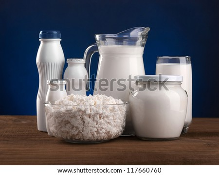 Different dairy products: cheese, sour cream, milk, yogurt, kefir. On a blue background. - stock photo