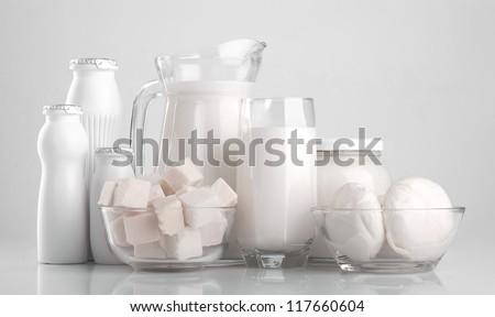 Different dairy products, cheese, yogurt, milk, yogurt, sour cream, mozzarella - stock photo