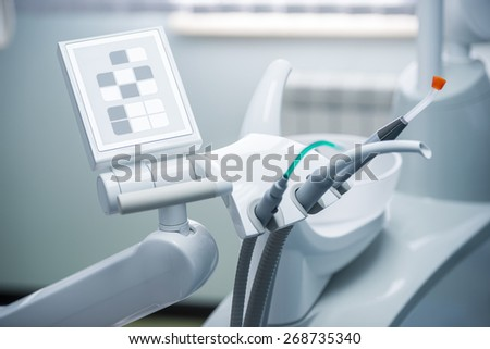 Different dental instruments and tools in a dentists office - stock photo
