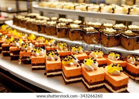 Different dessert cakes for sale at the shop - stock photo
