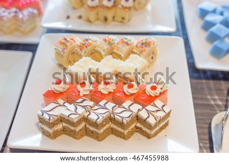 different dessert cakes in white dish