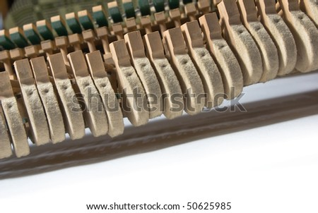 Different details and parts of the ancient piano close up