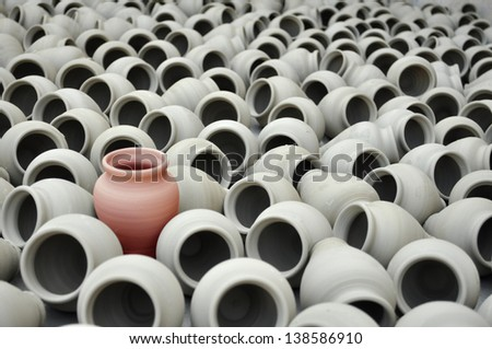 Different, different red pot, stand out from the crowd  - stock photo