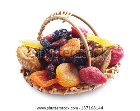 Different dried fruits in a wicker basket on white - stock photo