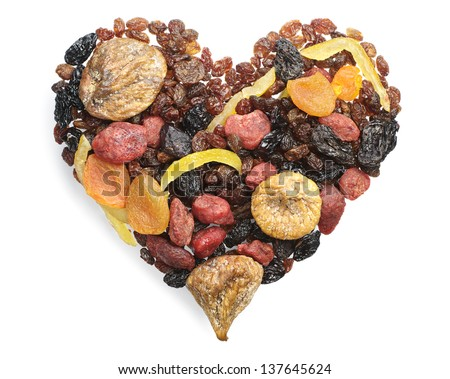 Different dried fruits in the shape of hearts on white - stock photo