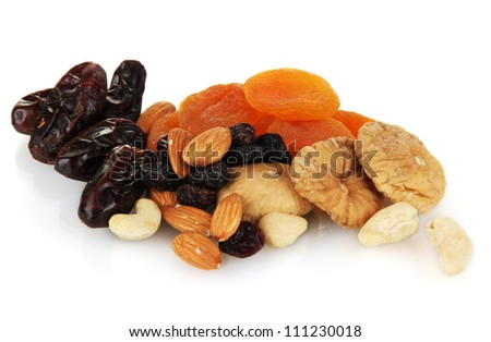 different dried fruits isolated on white - stock photo