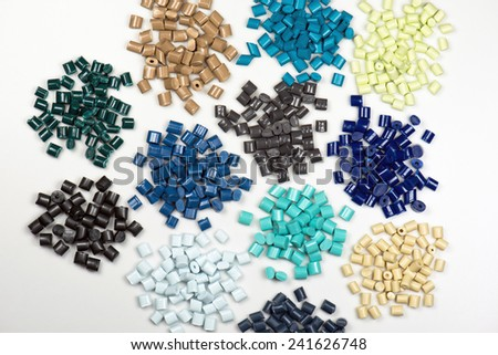 different dyed plastic pellets for injection molding process - stock photo