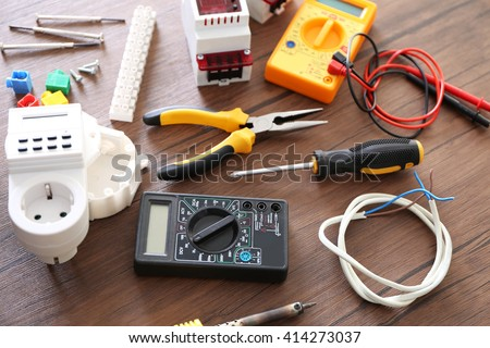 Different Electrical Tools On Wooden Table Top View