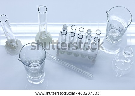 Different empty laboratory glassware on white table