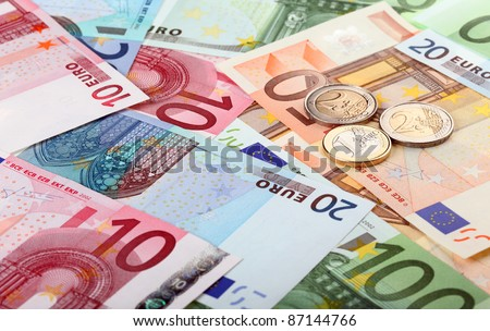 Different euro banknotes and coins - stock photo