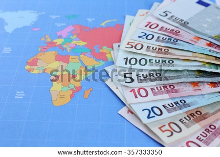 Different euro banknotes on a map background - stock photo
