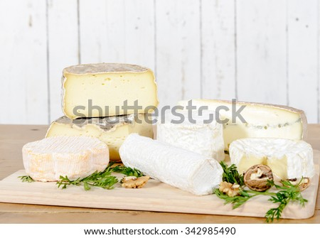different french cheeses placed on old table