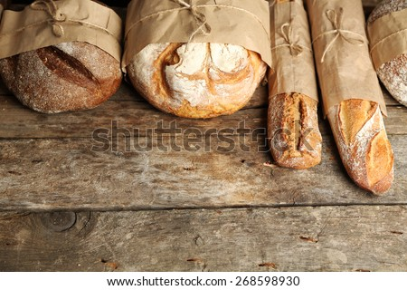 Different fresh bread, on old wooden table