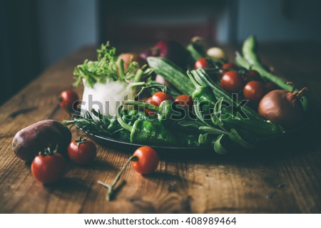 Different fresh farm vegetables on wooden table. Autumn harvest and healthy organic food concept. Toned picture - stock photo