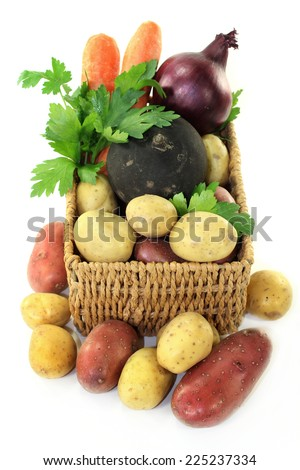different, fresh vegetable varieties in a basket - stock photo