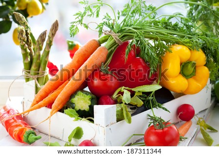 Different fresh vegetables in a box - stock photo