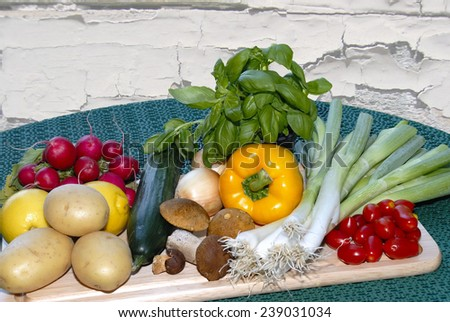 Different fresh vegetables on a table. - stock photo