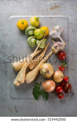 Different fresh vegetables on tray, selective focus - stock photo